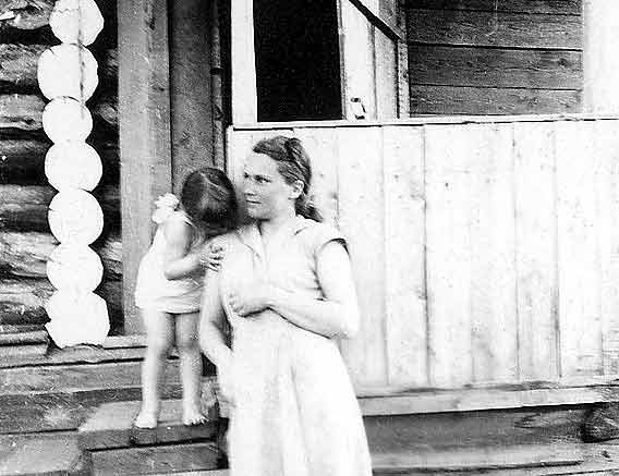 Sandra and her mother, Ligita, outside their house in Togur, 1955