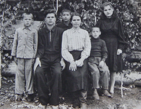 Just after arriving at the place of deportation, Anna's mother with all her children