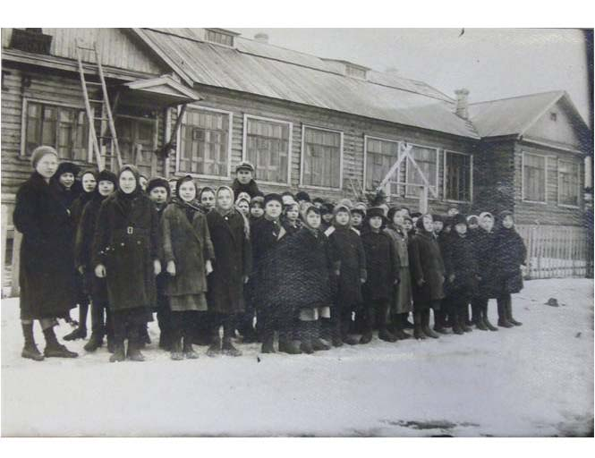 Pupils outside the school in a labour village, 1937
