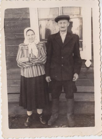 His parents, end of the 1950ies, in front of an house where lived two families
