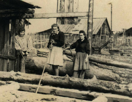 Eela (right) and others engaged in logging work, Magadan
